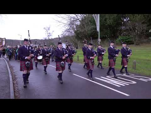 Vale Of Atholl Pipe Band lead parade to the river Tay from Kenmore Hotel, Scotland, Jan 2019