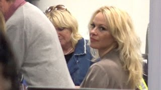 Pamela Anderson Makes Her Way Through Security