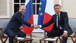 Putin and Macron hold talks in southern France
