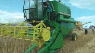 Vintage combine harvesters working