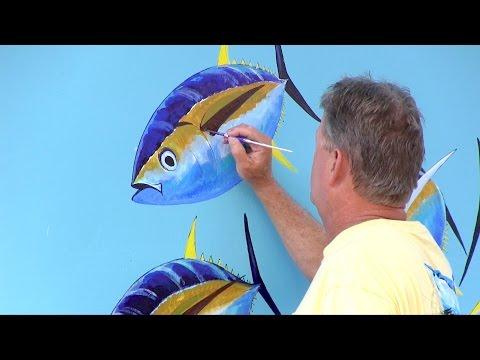 Guy Harvey puts finishing touches on Mako mural at SeaWorld Orlando