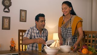 Happy wife serving home cooked food to her husband with love and care - Family bonding