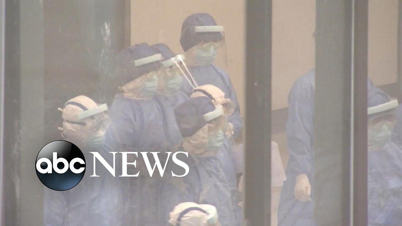 London flight placed on lockdown after passenger shows symptoms of coronavirus | ABC News