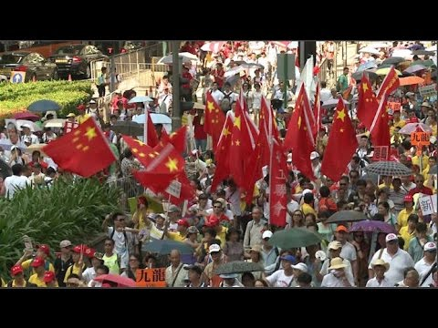 Tens of Thousands of pro-Beijing Protesters March in Hong Kong
