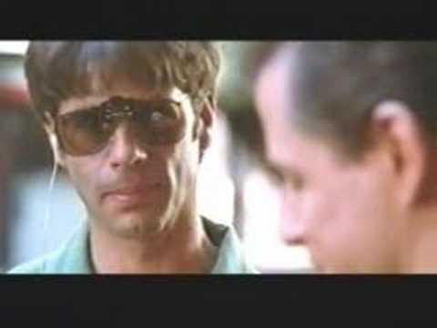Lorenzo Lamas and Michael Pare in THE DEBT
