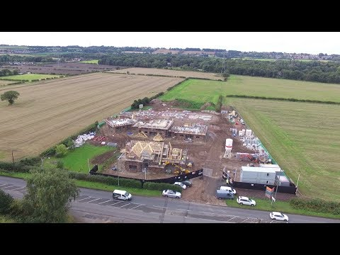 New Homes - Aerial view of The Coppice, Plots 7 ready for roof tiling - by Wonderful Homes