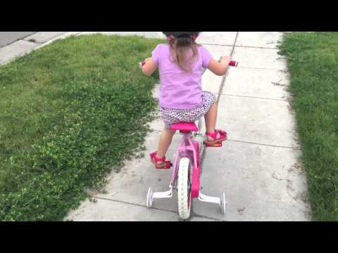 Year Old Toddler Rides Bike With Training Wheels