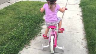 2 year old toddler rides a bike (with training wheels!)