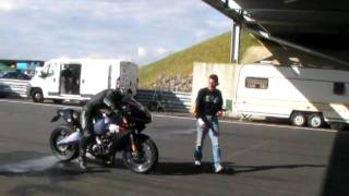 1125r buell is challenged by stunt man craig jones to drag race
