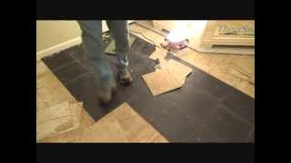 Removing vinyl floor tiles with a putty knife
