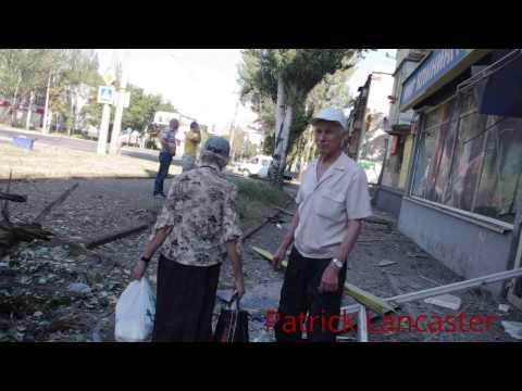 RAW Artillery strike residential area 7am Kievskiy Ave. Donetsk Apartment building & shops Ukraine
