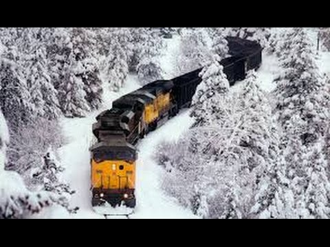 awesome-powerful-train-plow-through-snow-railway-tracks