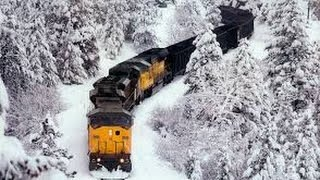 Awesome Powerful Train plow through snow railway tracks thumbnail