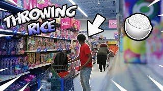Throwing Rice at Strangers Prank in Walmart!!!!!