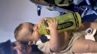 Baby Logan eats giant crayon