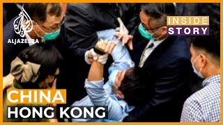 How much of a headache is Hong Kong to China?   Inside Story