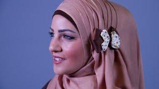 موديلات حجاب مع الطيات والفراشة الجانبية