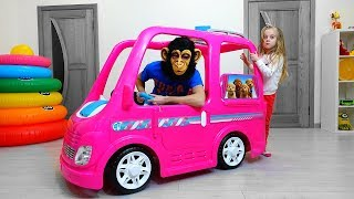 Girl play with Giant Barbie Car - Dream Camper