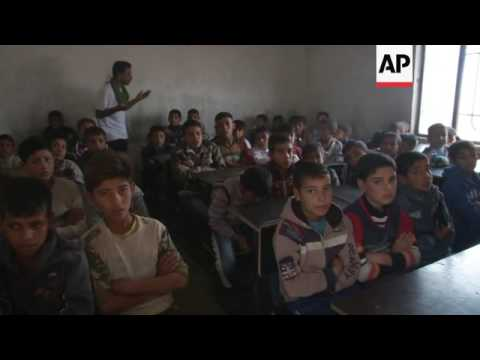 School south of Mosul re-opens after IS driven out