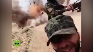 Soldado capta la explosión de una mina al paso de un convoy del Ejército sirio