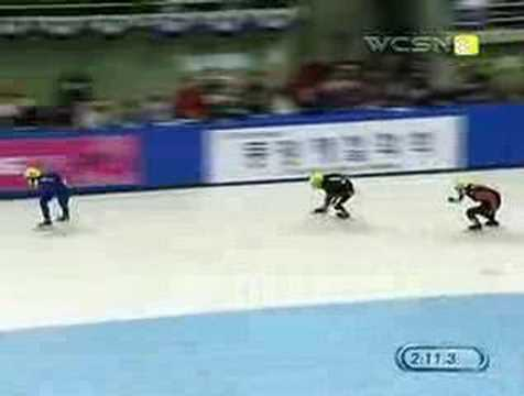 Speed Skaters Jeff Simon and Zhang Zhiqiang go down