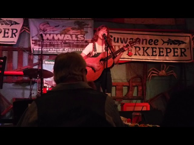 Photo: Sara and Scotti Jay for WWALS, of Sabrina Deetz singing Take me to the Suwannee at the 2019 Suwannee Riverkeeper Songwriting Contest.