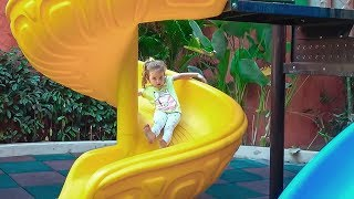 Milusik playing  with baby on the Outdoor Playground for kids