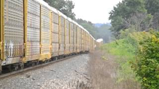 A very long CSX autorack train over 9,943 ft long   almost 2 miles with loaded autoracks