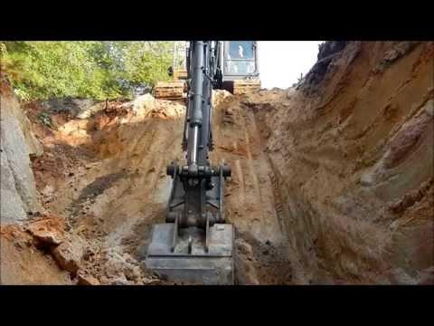 Excavator Digging A Borrow Pit