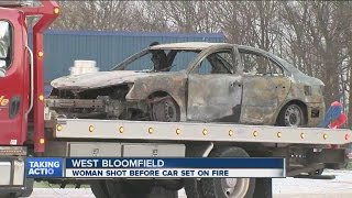 Woman shot before car set on fire