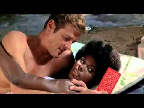 1973   Live and let die   Rosie Carver and bond on beach