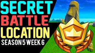 Fortnite SECRET BATTLE STAR Location WEEK 6 - Search where the Stone Heads are looking