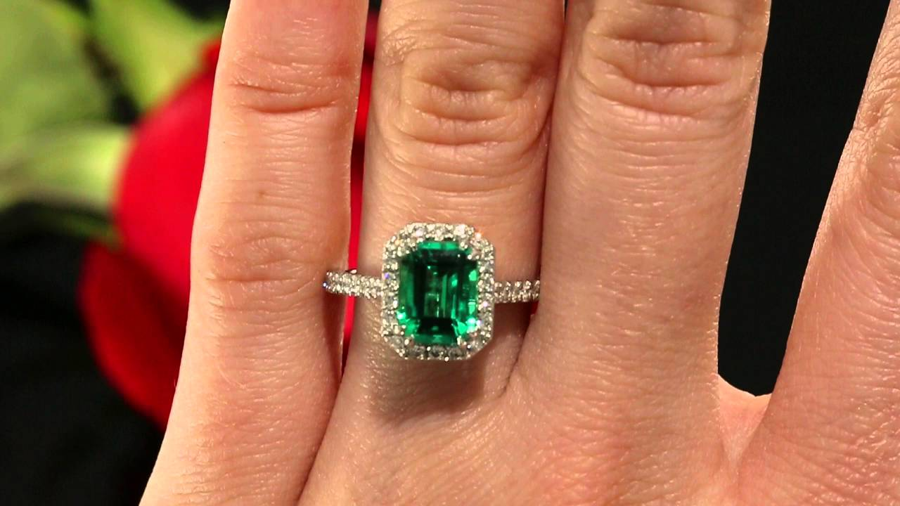 chatham emerald and halo engagement ring in 14k