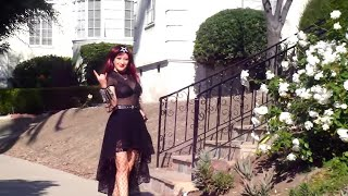 Gothic fashion by Sofia Metal Queen. Black lace skirt & exotic handbag