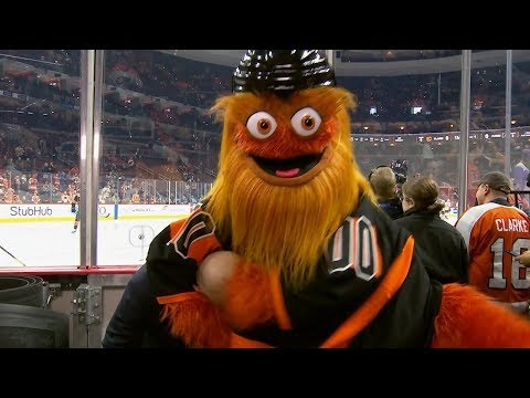 Gritty crashed the Flames' broadcast and put their announcer in a headlock