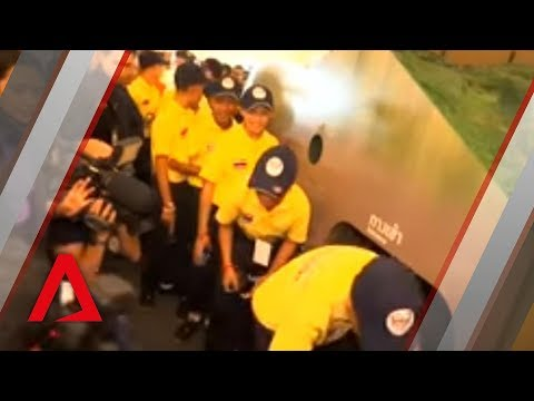 Video: Young Thai footballers made to relive their traumatic rescue from cave for the public