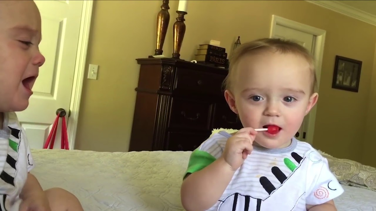 Cutest TWIN BABIES Fighting over Lolipop - FUNNY Baby videos!