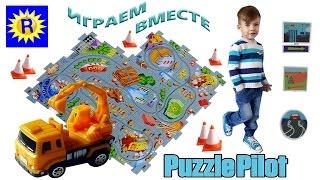 Ринат играет с машинкой Puzzle Pilot Excavator Truck