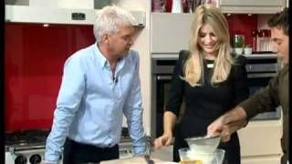 Holly and Phil laugh at Gino