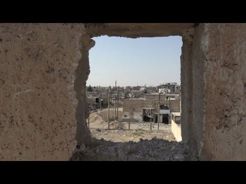 Syria: US-backed forces inspect damage in a Raqa neighbourhood