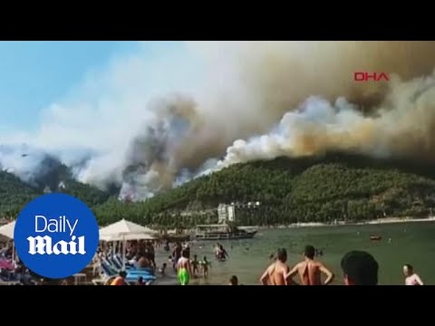 Tourists evacuated as raging fire threatens holiday resort in Turkey