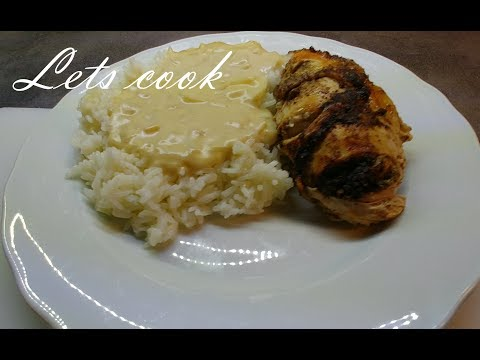 Oven baked garlic stuffed chicken with rice and onion gravy
