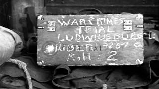 German prisoners arrive at Ludwigsburg Palace during World War II war crime trial...HD Stock Footage