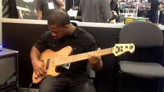 Namm Show 2014  Booth  Utrera Basses. Marcus. Fletcher  Playing  Classic Pro Single Cut