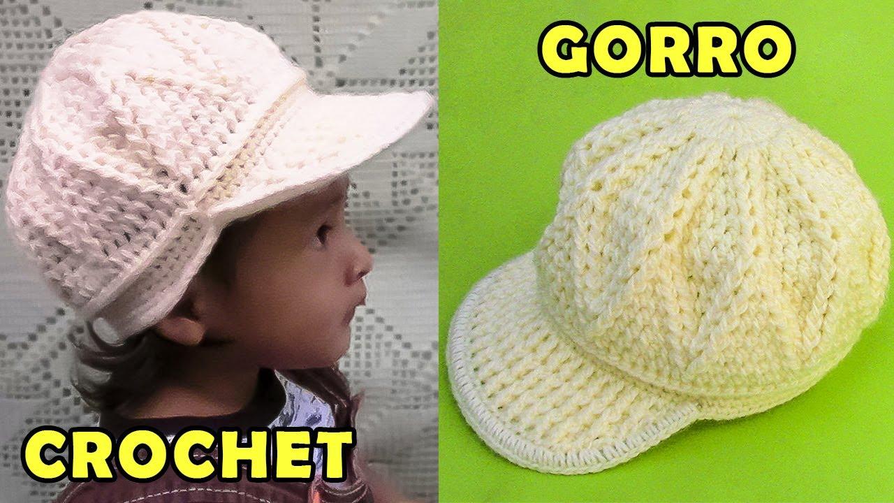 52e8455ba8bfd Gorra con vicera tejido a crochet para niños de 1 a 3 años