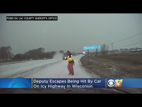 Deputy Narrowly Escapes Being Hit By Vehicle On Icy Road
