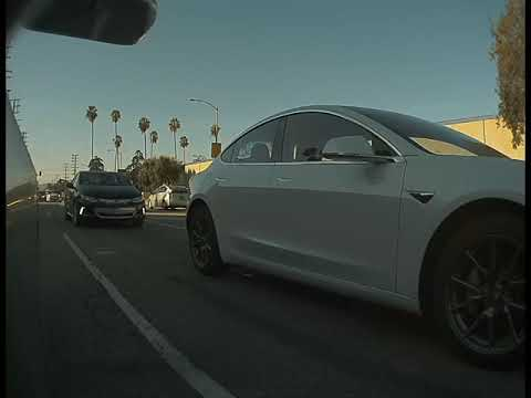 Watch This Tesla Save A Police Officer From An Accident