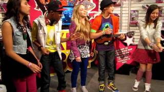 "Kidz Bop Kids at the International Toy Fair in New York singing ""Born This Way."""