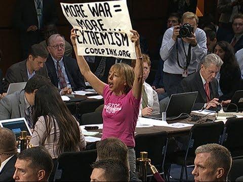 Raw: Anti-war Protesters Disrupt Senate Hearing