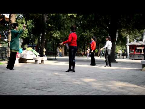 Chinese Woman Dancing in Park - Beijing Vacation